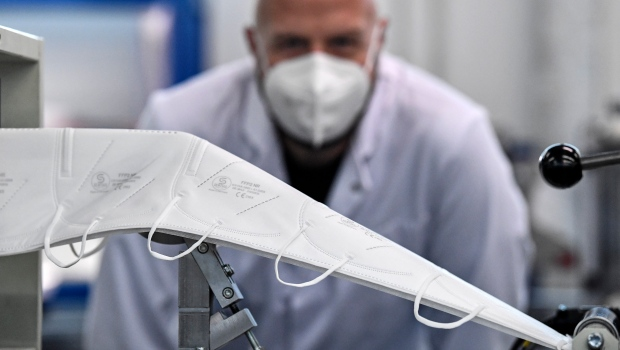 Worker inspecting mask production